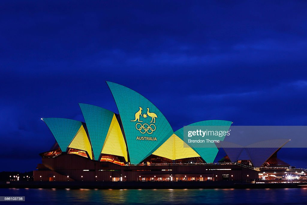 The Sydney Opera House is lit up green and gold to mark the Opening Ceremony of the 2016 Rio Olympic Games, at Sydney Opera House on August 5, 2016 in Sydney, Australia.