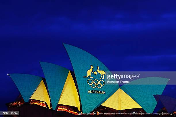 The Sydney Opera House is lit up green and gold to mark the Opening Ceremony of the 2016 Rio Olympic Games at Sydney Opera House on August 5 2016 in...