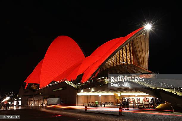 The Sydney Opera House is lit up red ahead of World AIDS Day 2010 on November 30 2010 in Sydney Australia More than 80 iconic landmarks across 13...