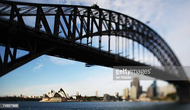 The Sydney Opera House is visible under the Sydney Harbour Bridge June 28 2007 in Sydney Australia The Opera House designed by Joern Utzon and...