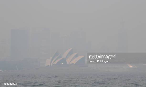The Sydney Opera House shrouded in thick smoke on December 19, 2019 in Sydney, Australia. NSW Premier Gladys Berejiklian has declared a state of...