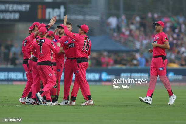 The Sydney Sixers celebrate a wicket during the Big Bash League match between the Sydney Sixers and the Adelaide Strikers at Coffs International...
