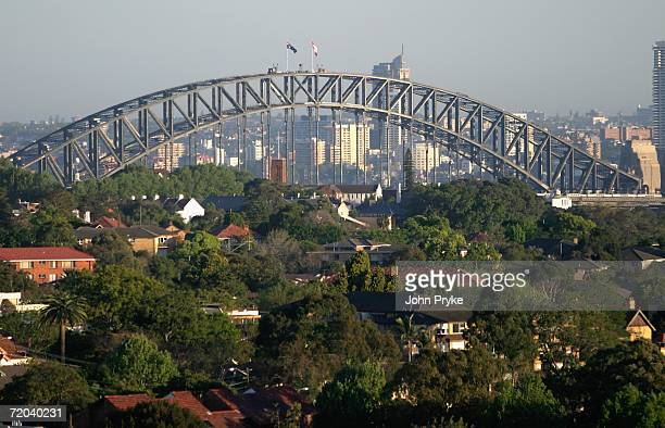 The Sydney Swans Australian Rules Football team flag flies alongside an Australian flag atop the Sydney Harbour Bridge September 29, 2006 in Sydney,...