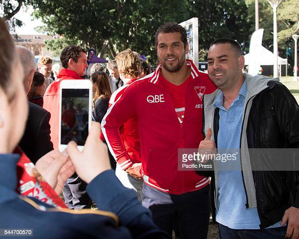 PARK SYDNEY NSW AUSTRALIA The Sydney Swan's Lance Franklin greets fans at the launch of their Reconciliation Action Plan along with Dane Rampe who...