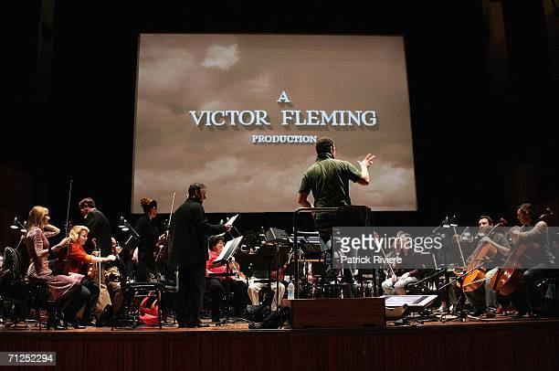 The Sydney Symphony Orchestra during a rehearsal of 'The Wizard of Oz' in front of a big screen in the Concert Hall of the Sydney Opera House June 21...