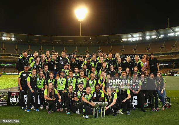 The Sydney Thunder men's and women's team pose after winning their respective finals in the Big Bash League final match between Melbourne Stars and...