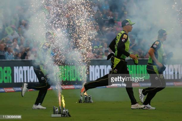 The Sydney Thunder runs out during the Big Bash League match between the Sydney Thunder and the Hobart Hurricanes at Manuka Oval on February 09 2019...
