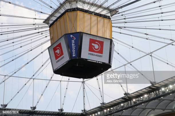 The symbol for the video assistant referee VAR is seen on the screen during the Bundesliga match between Eintracht Frankfurt and Hertha BSC at...