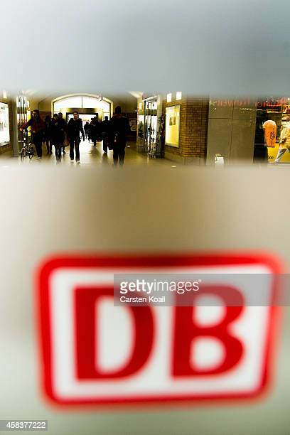 The symbol of the Deutsche Bahn railway company is seen on a glass door at the railway station at Alexanderplatz on November 4 2014 in Berlin Germany...