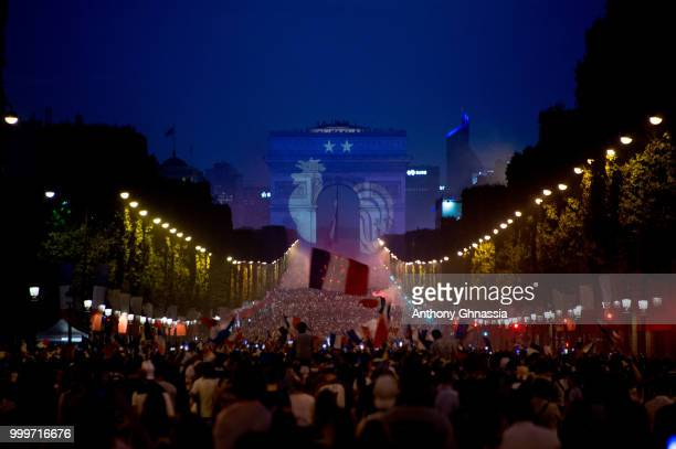 The symbol of the French national team is projected onto the Arc de Triomphe as fans celebrate France's victory over Croatia in the 2018 FIFA World...