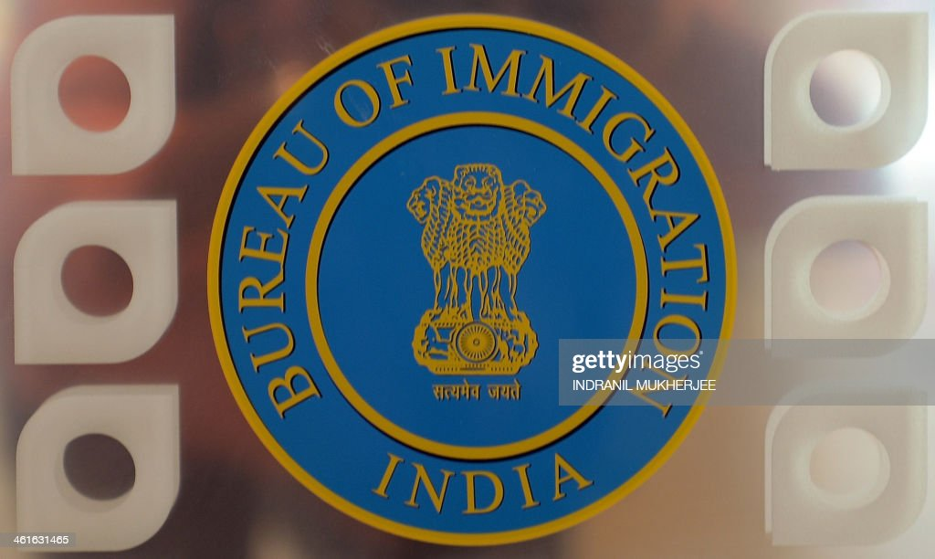 The symbol of the indian bureau of immigration is seen on a