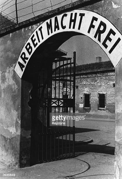 The symbolic inscription above one of the entrance gates at the concentration camp of Terezin, Czechoslovakia, reads 'Arbeit Macht Frei' - an example...