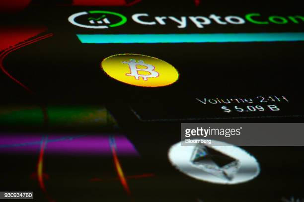 The symbols for Bitcoin and Ethereum cryptocurrency sit displayed on a screen during the Crypto Investor Show in London UK on Saturday March 10 2018...