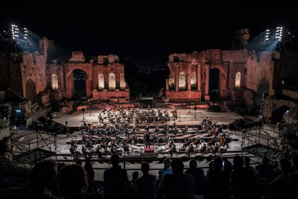 ITA: Massimo Bellini Theater Orchestra Performs At Teatro Antico in Taormina