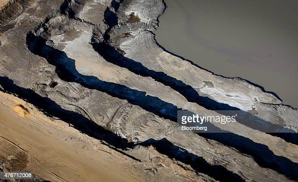 The Syncrude Canada Ltd oil sands mine stands in this aerial photograph taken near Fort McMurray Alberta Canada on Thursday June 4 2015 Canadian...