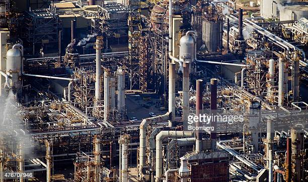 The Syncrude Canada Ltd oil sands upgrading plant stands in this aerial photograph taken near Fort McMurray Alberta Canada on Thursday June 4 2015...