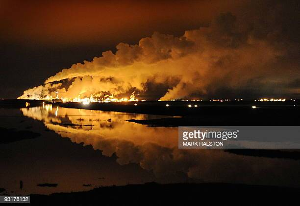 The Syncrude oil sands extraction facility is reflected in a lake reclaimed from an old mine near the town of Fort McMurray in Alberta Province...