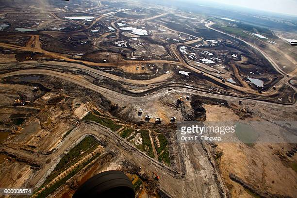 The Syncrude open pit oil excavation mine in Fort McMurray The top soil is removed to give access to the controversial tar sands The sand goes...