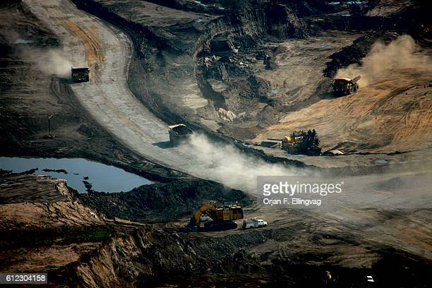 The Syncrude open pit oil excavation mine in Fort McMurray. The top soil is removed to give access to the controversial tar sands. The sand goes...