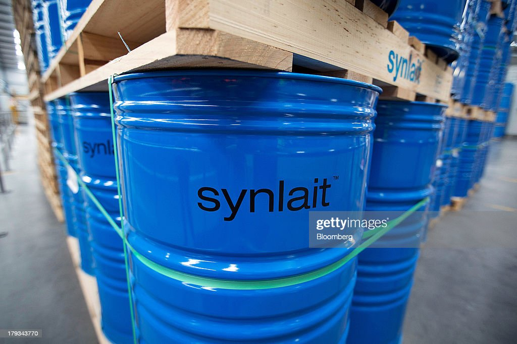 The Synlait Milk Ltd. logo is displayed on drums of dairy products at the company's manufacturing plant in the town of Rakaia, 60km from Christchurch, New Zealand, on Friday, Aug. 30, 2013. Synlait, a unit of Shanghai-based Bright Dairy & Food Co., will process more milk than forecast in 2013-14, the company announced on Aug. 30. Photographer: Brendon O'Hagan/Bloomberg via Getty Images