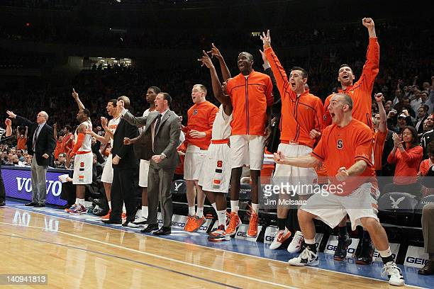 The Syracuse Orange bench reacts after a three pointer late in the game against the Connecticut Huskies during the quarterfinals of the Big East...