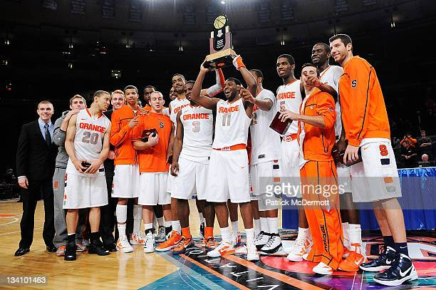 The Syracuse Orange celebrate after defeating the Stanford Cardinal to win the 2011 Dick's Sporting Goods NIT Season TipOff at Madison Square Garden...