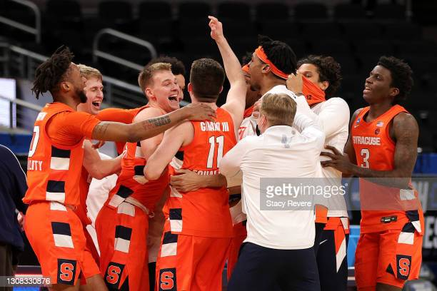 The Syracuse Orange celebrate their win over the West Virginia Mountaineers in their second round game of the 2021 NCAA Men's Basketball Tournament...