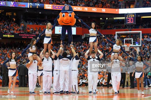 The Syracuse Orange cheerleaders and mascot Otto perform during a timeout against the Virginia Cavaliers in the second half at the Carrier Dome on...