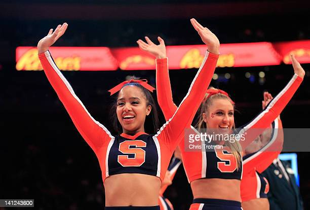 The Syracuse Orange cheerleaders perform during a timeout against the Louisville Cardinals during the semifinals of the Big East men's basketball...