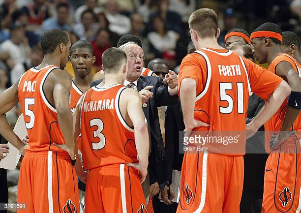The Syracuse Orangemen huddle in the second round game of the NCAA Division I Men's Basketball Tournament against the Maryland Terrapins at the Pepsi...