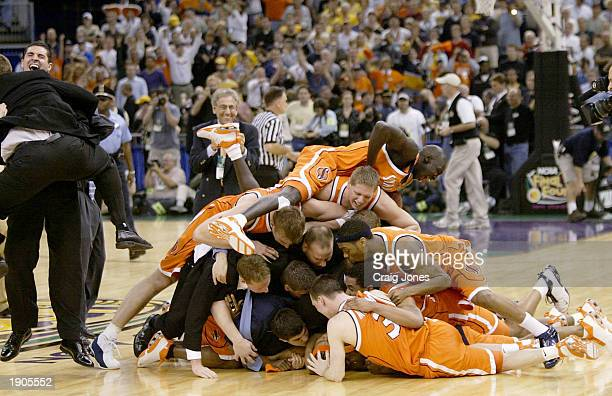 The Syracuse team celebrates at center court after defeating Kansas during the championship game of the NCAA Men's Final Four Tournament on April 7,...