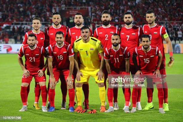 The Syria players line up for a team photo during the AFC Asian Cup Group B match between Syria and Palestine at Sharjah Stadium on January 6 2019 in...