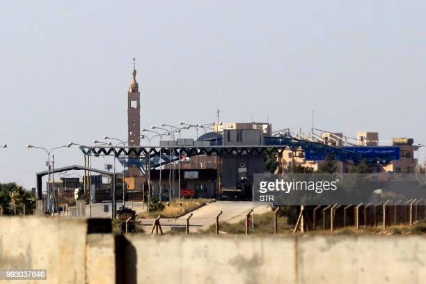 The Syrian border control building can be seen from the Jordanian Mafraq governate at the Nassib crossing between the two countries on June 7 2018...