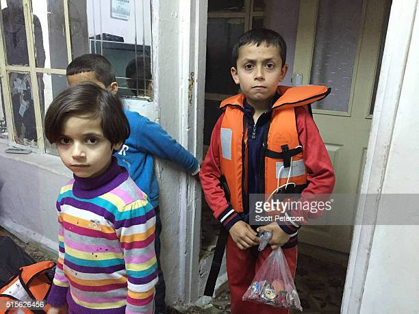The Syrian family of Mehdi Oso along with his wife and five children prepare their lifejackets for a third attempt to pay smugglers to cross to...