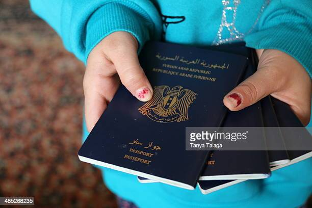 The Syrian passports of the Hannan family who fled Damascus one year ago for Istanbul They may have left utter destruction but now the family lives...