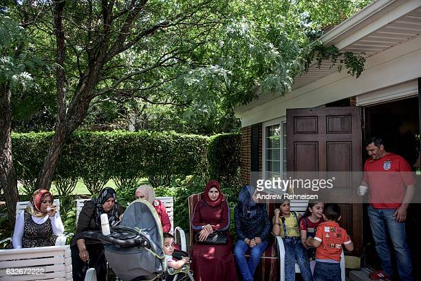 The Syrian refugee community attend a local potluck together on August 1 2015 in Bloomfield Hills Michigan The community is expecting seven more...
