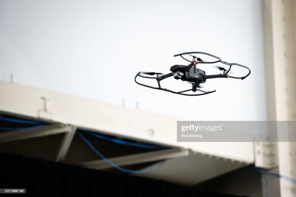 The SZ DJI Technology Co Mavic 2 Pro Drone Flies Into An Event Space After