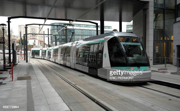 The T6 tram leaves the Chatillon-Montrouge station in Chatillon during a press presentation on December 1, 2014 ahead of the inauguration of the new...