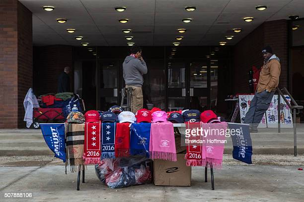 The table of a vendor selling Trump merchandise ahead of a rally with Republican presidential candidate Donald Trump at the Ramada Waterloo Hotel and...