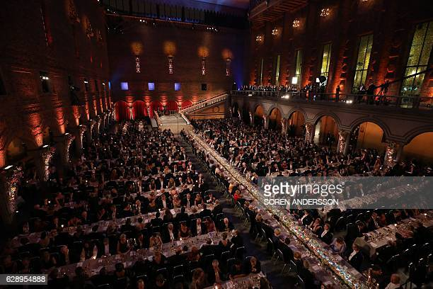 The Table of Honour is surrounded by other tables during the 2016 Nobel Banquet for the laureates in medicine chemistry physics literature and...