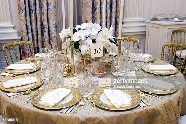 The table settings in the State Dining Room for the White House dinner Wednesday, Nov. 2 in honor of the Prince of Wales and Duchess of Cornwall....