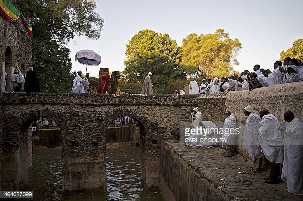 The tabots from St Michael's churches leave the Fasilides baths as Ethiopian Orthodox Christians pray during the Timkat festival in Gondar on January...