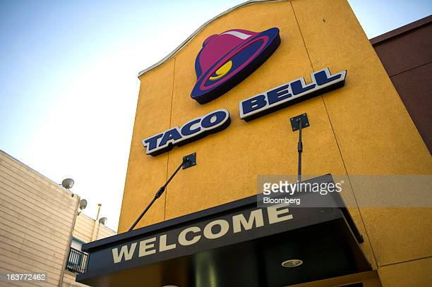 The Taco Bell Corp logo is displayed on the facade of a restaurant in San Francisco California US on Wednesday March 13 2013 Taco Bell sales began to...