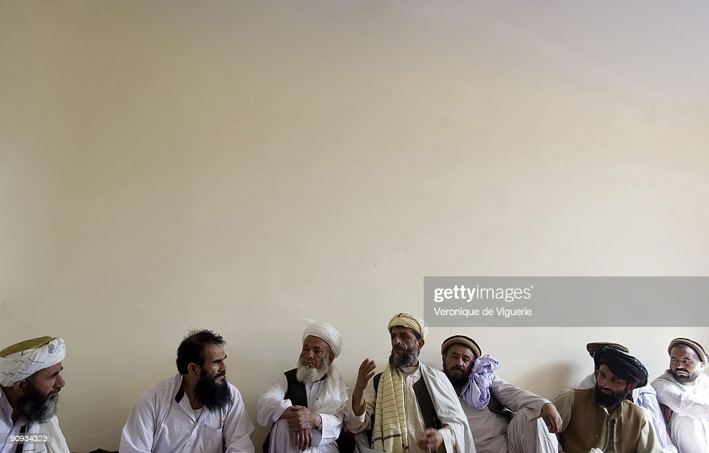The Tagab district, 50km away from Kabul, is controled by the Taliban and Hezbi-Islami. The allied foreign forces are having trouble removing them. Pictured is a shura (tribal meeting) in Tagab with the district chief (wearing no hat).