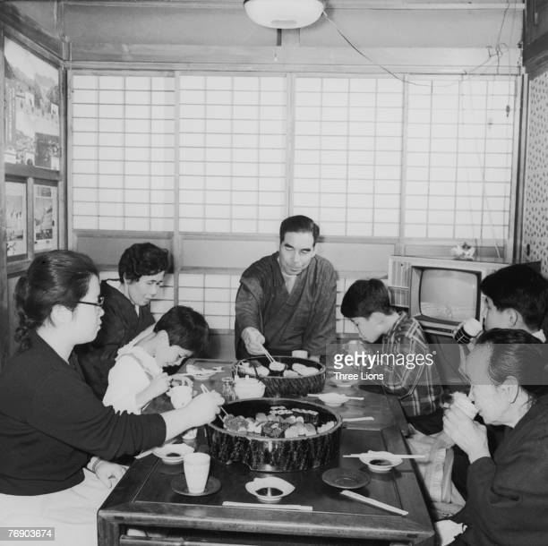 The Taguchi family sit down to breakfast in Japan circa 1965