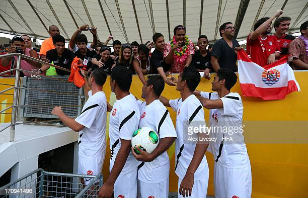 The Tahiti players greet their fans prior to the FIFA Confederations Cup Brazil 2013 Group B match between Spain and Tahiti at the Maracana Stadium...