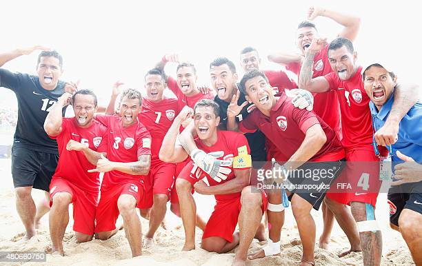 The Tahiti team celebrate after victory in the Group D FIFA Beach Soccer World Cup match between Russia and Tahiti held at Espinho Stadium on July...