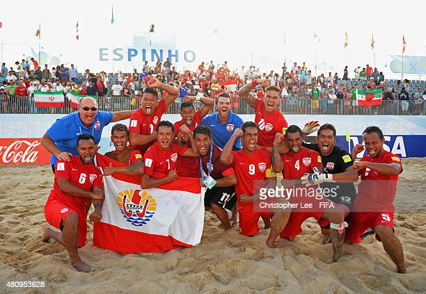 The Tahiti team celebrate their victory during the FIFA Beach Soccer World Cup Quarter Final match between Tahiti and Iran at Espinho Stadium on July...