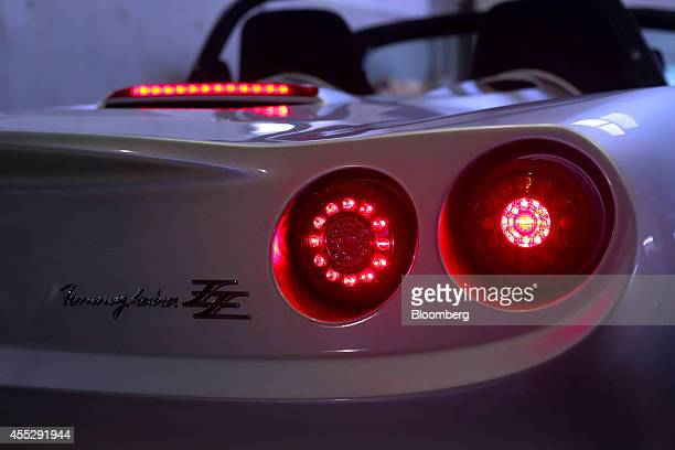 The tail and spoiler lights of a GLM Co Tommykaira ZZ electric vehicle are illuminated at the company's RD facility in Uji Kyoto Prefecture Japan on...