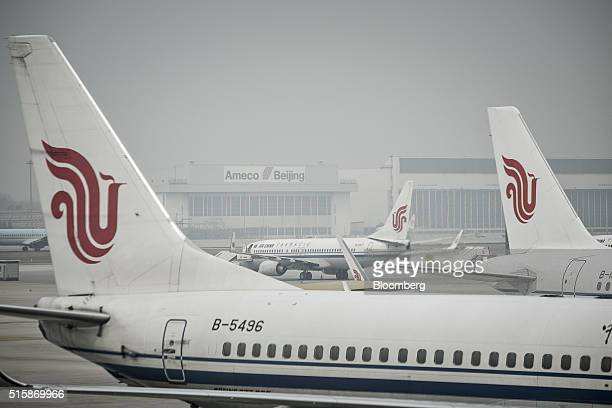 The tail fins of Air China Ltd aircraft are seen at Beijing Capital International Airport in Beijing China on Tuesday March 15 2016 China's big three...